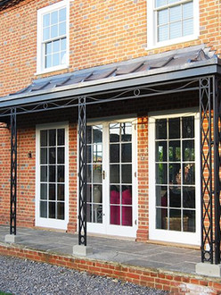 Bespoke cast iron canopy with zinc roofing.