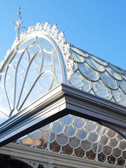 Highly intricate bespoke cast iron and glass canopy.