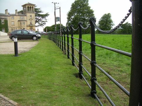 Cast posts with round rail and chain.
