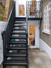 One of our signatures cast iron external staircases. With cast balusters, cast treads and laser cut steel stringers. Finished in gloss black this is a lovely example of a replica period staircase.