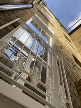 Classic Victorian pattern used here for a Juliet balcony in front of a large window in central London.