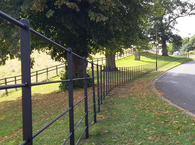 Estate Fencing with Round Rail.jpg