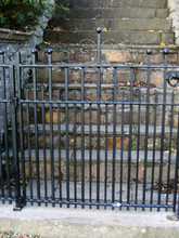 Small fabricated steel entrance gate with decorative scrolls – this gate was for a church.