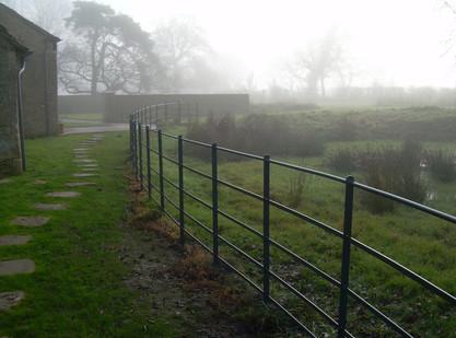 estate railings shrowded in morning mist