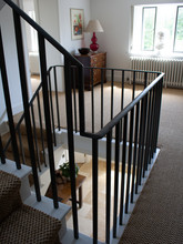Contemporary internal balustrade made from hand bent and fabricated mild steel.