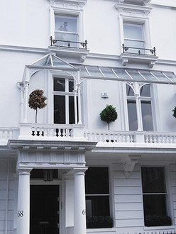 Classic Victorian style Cast iron canopy installed over stone balconies – central London