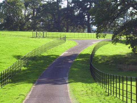 sweeping driveway with our traditional estate fencing boadering both sides.