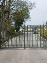 Handmade bespoke fabricated steel double gates with cast iron finials