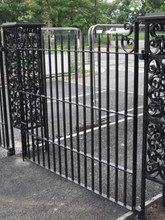 Intricate wrought iron gate posts with fabricated gate and railings. Produced by our blacksmith.
