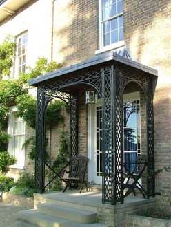 Bespoke cast iron canopy with zinc roof.