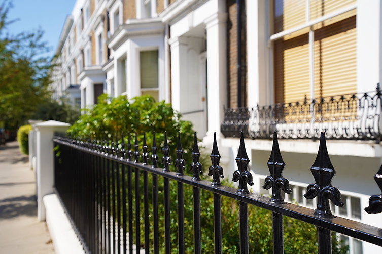 Railings painted black with decorative finials