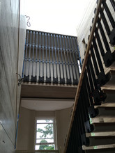 Exceptional contemporary cast iron and mild steel balustrade with additional landing protective screen.