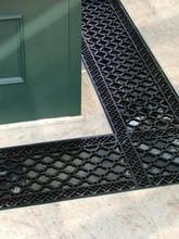 Installed cast iron floor grilles