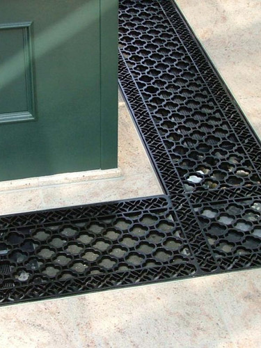 Installed cast iron floor grilles