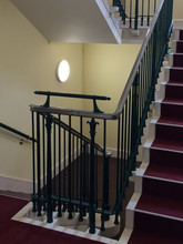 Exquisite cast iron and solid cast bronze balusters and newel posts. A bespoke creation for Eton College.