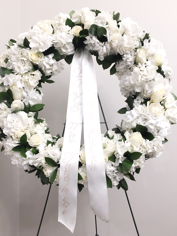 Lush White Funeral Arrangement
