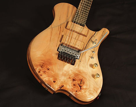 raadotar 6-string electric guitar - masterbuilt - custom wooden pickup covers - ambrosia maple top and back wood - graph tech ghost lb63 piezo-loaded floating tremolo - hipshot grip-lock locking tuners - custom kitara suomesta - made in finland - bare knuckle pickups ragnarok set