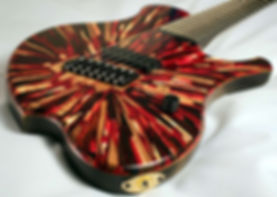 Raadotar 7-string multiscale guitar raato custom guitars - bare knuckle pickups nailbomb ceramic - hipshot hardware - custom epoxy resin guitar top with wood explosion pattern - red glitter guitar - made in finland - custom kitara suomesta