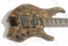 "Raato Custom Guitars 35"" - 33,5"" Multiscale Electric Bass, Lichtenberg Wood Burning figures on guitar, Custom Inlays, Delano MC5 FE, Delano PMVC5 FE pickups, Hipshot Products Inc., Hipshot Solo Rail Bridge, Hipshot Tuning Machines, S-Tool, Metal bass, 5-string bass, custom bass guitar, custom basses"