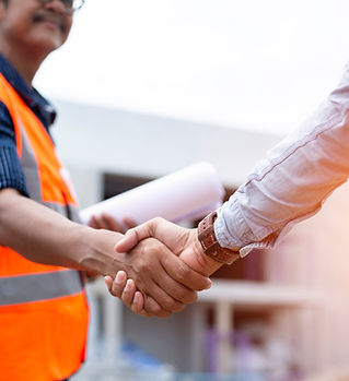 Engineer man handshake with asian busine
