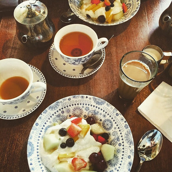 Breakfast at Dishoom, best brunch in London, fruit salad and yogurt, chai tea