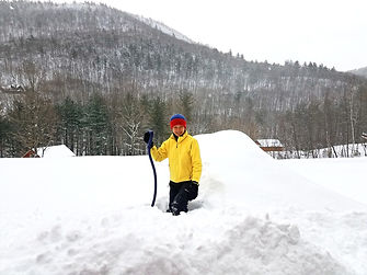 Digging snow with shovel