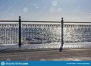 wrought-iron-railing-pier-shadows-sunlig