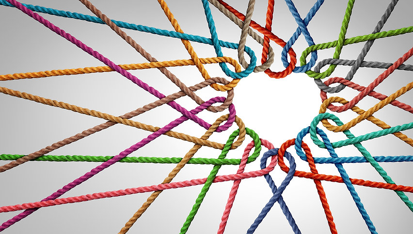 Unity and love partnership as ropes shaped as a heart in a group of diverse strings connec
