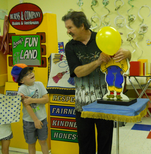 Little boy laughs at Willies balloon head!
