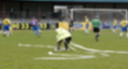 Billy Alexander clearing the pitch.JPG