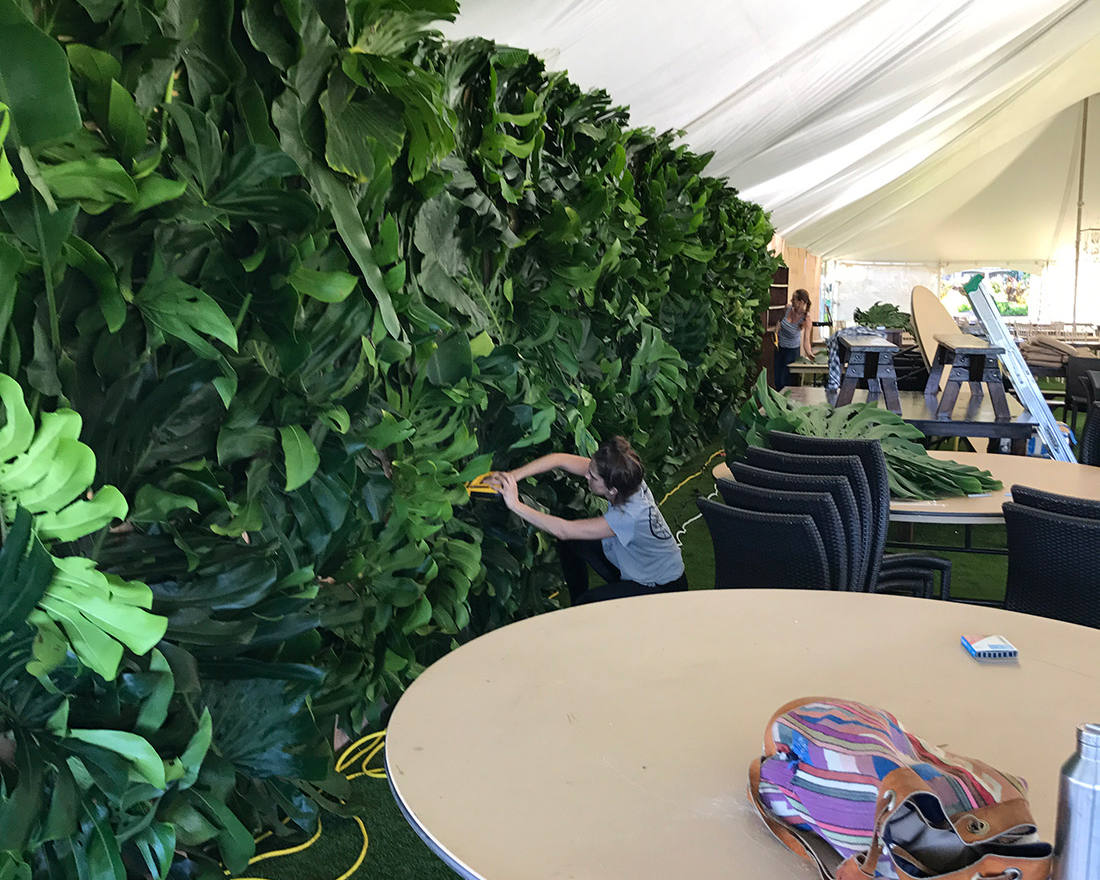 Green floral design of walls in an event tent