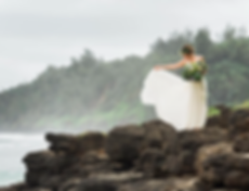 Bride on Kauaii ocean wth flowers and floral headdress