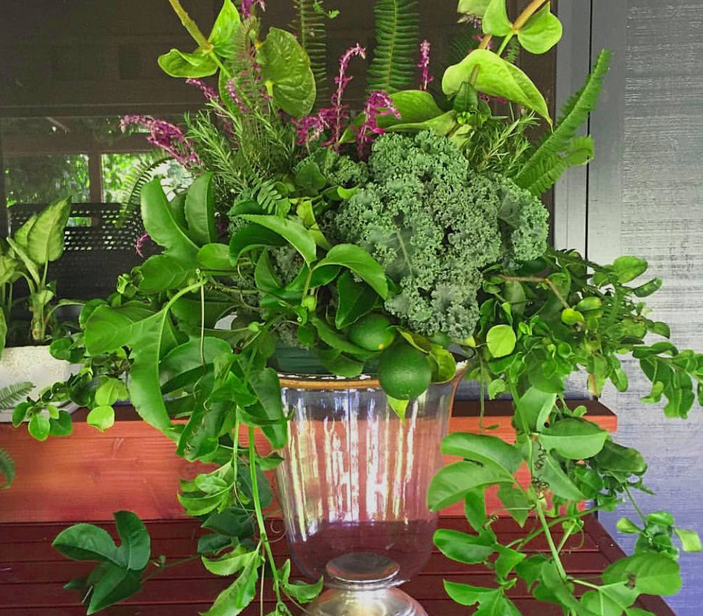 Natural green flowers in clear vase