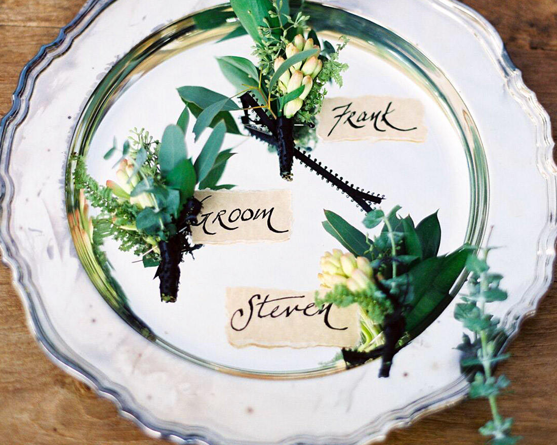 Wedding welcome plate with floral and greenery