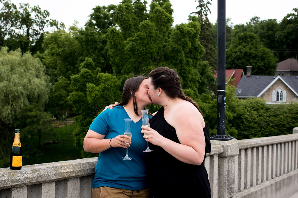 couple toasting and kissing after getting engaged