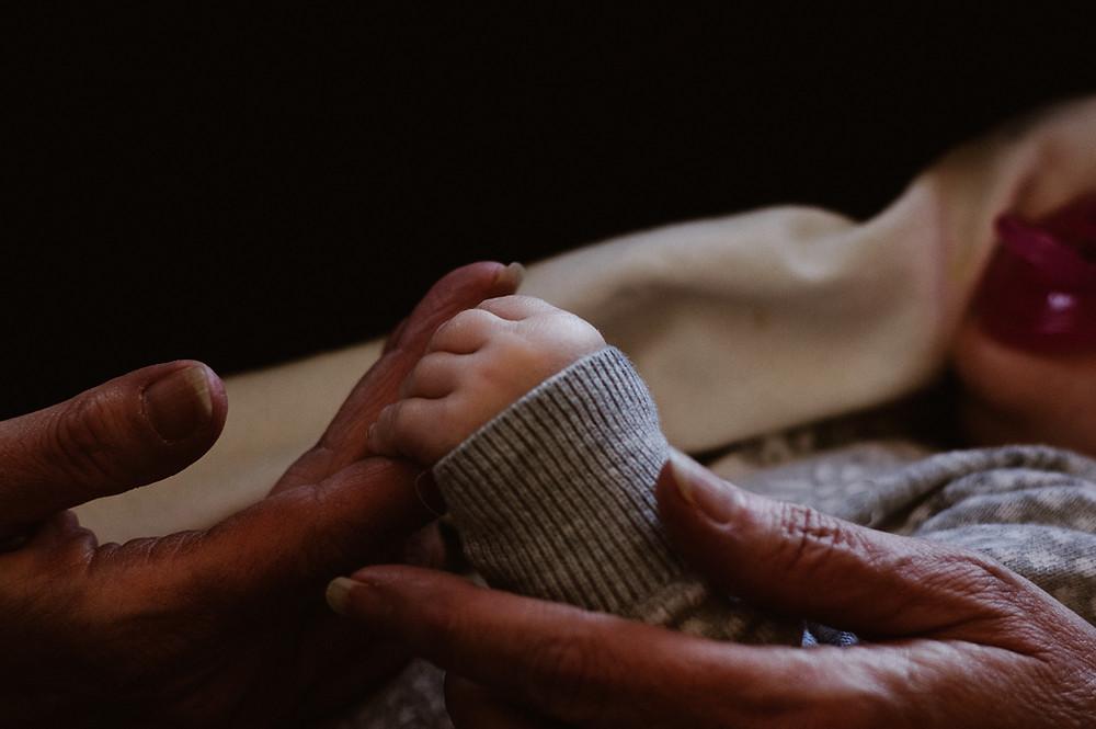 Baby Granddaughter holding Grandmother's finger