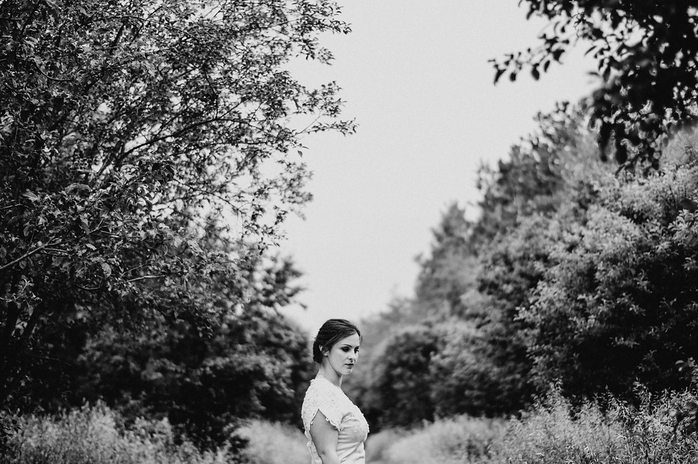 black and white image of bride in trees