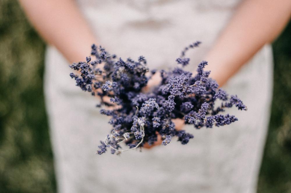 lavender bouquet in brides hands