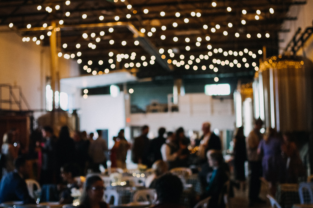 blurry bokeh romantic brewery wedding string lights