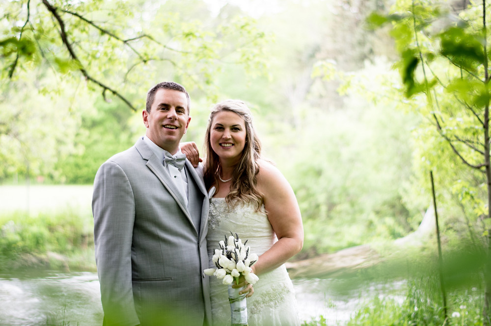 Bride and groom portrait near the river at Sidrabene Camp and Retreat in Burlington, Ontario