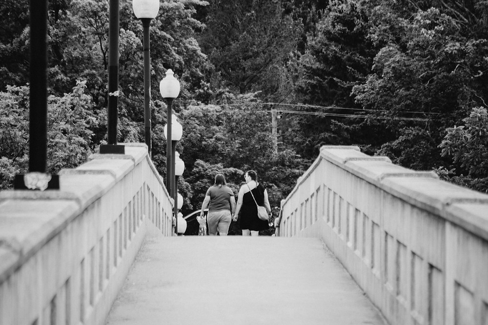 couple walking across Heffernan Street Footbridge