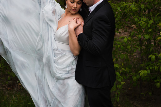 dramatic bride and groom portrait with wind
