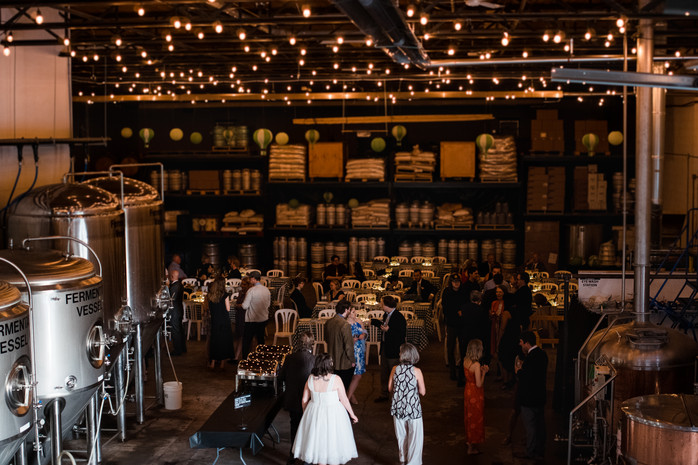 string lights at a cute brewery wedding reception