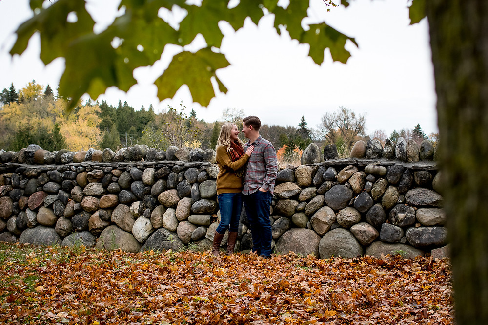 engagement photo against stone wall