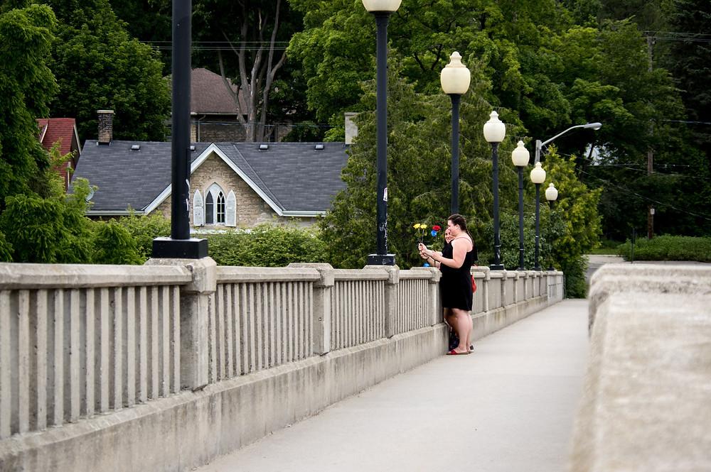 flower ceremony on footbridge downtown Guelph