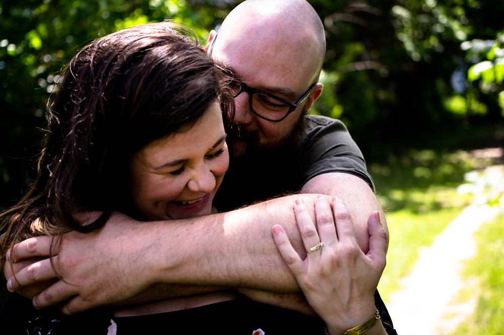 couple smiling and embracing