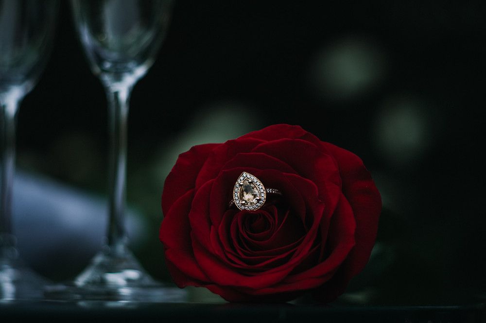 custom engagement ring in a red rose
