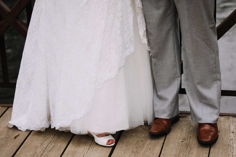 Detail shot of the bride and grooms shoes