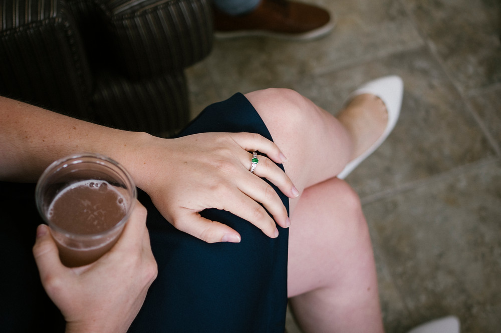 emerald engagement ring, punch, white flats