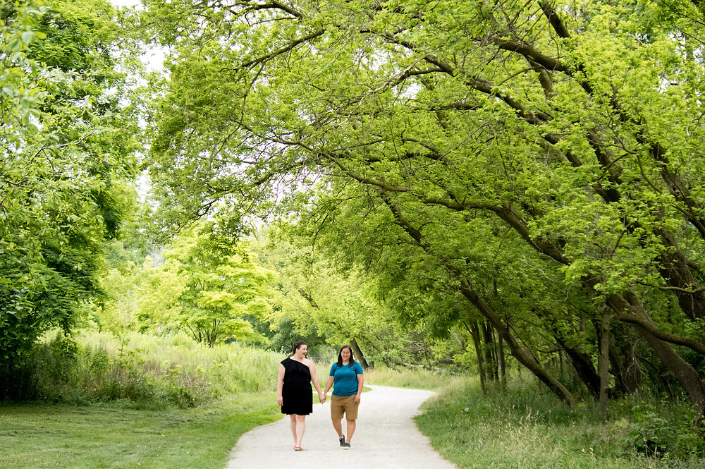 couple walking holding hands in Goldie Mill Park